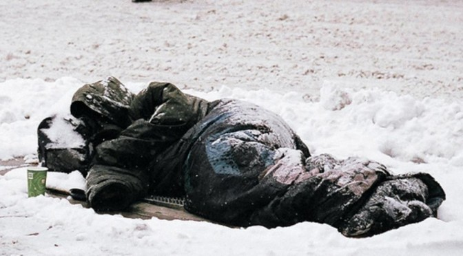 homeless sleeps in snow
